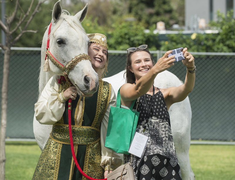 Arabian gelding CP Abercrombey and Isabel Maskiewicz get a selfie with a visitor during the 2018 Cal Poly Pomona Tasting and Auction at Cal Poly Pomona