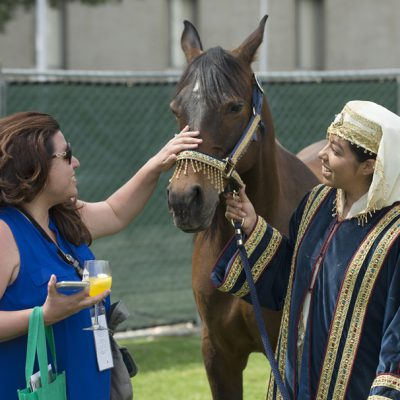 Arabian mare Pistolera led by Lizbet Felix meets Mercedes Quiroz at the 2018 Cal Poly Pomona Tasting and Auction at Cal Poly Pomona