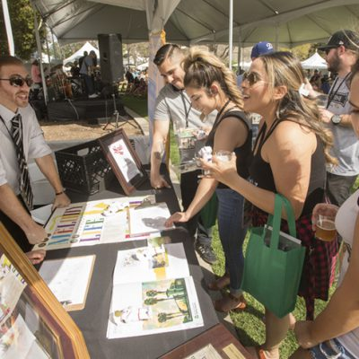 Elijah Koerner talks about the Cal Poly Rose Float during the 2018 Cal Poly Pomona Tasting and Auction at Cal Poly Pomona